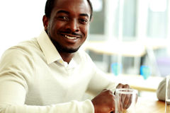 African businessman sitting at the table Stock Image