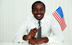 African businessman sitting at the table Royalty Free Stock Images