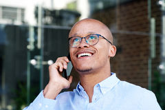 African businessman smiling with cell phone Royalty Free Stock Image