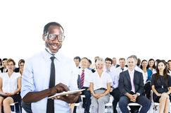 African Businessman Standing in Front of the Crowd Royalty Free Stock Photography