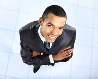 African businessman standing outside with crossed arms Royalty Free Stock Photos
