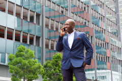 African businessman talking on mobile phone in the city street Stock Images