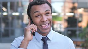 African Businessman Talking on Phone Outdoor. 4k high quality, 4k high quality stock video footage