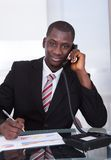 African businessman talking on telephone Stock Image
