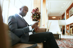 African businessman waiting in hotel lobby Royalty Free Stock Photo