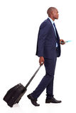 African businessman walking. African american businessman walking with trolley bag on white Royalty Free Stock Photos