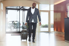African businessman walking in hotel lobby Stock Image