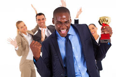African businessman winning. Excited african american businessman winning a trophy Stock Image