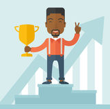 African businessman on winning podium Stock Photo