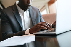 African businessman working on laptop at cafe Royalty Free Stock Photo