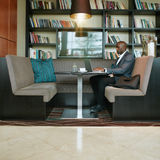 African businessman working on laptop at cafe Royalty Free Stock Image