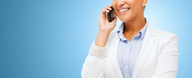 African businesswoman calling on smart phone Stock Photo