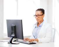 African businesswoman with computer in office Stock Image
