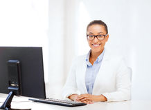 African businesswoman with computer in office Stock Photography