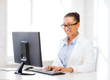 African businesswoman with computer in office Royalty Free Stock Image