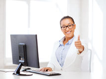 African businesswoman with computer in office Royalty Free Stock Images