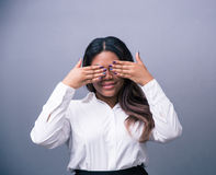 African businesswoman covering her eyes Royalty Free Stock Image