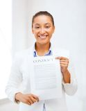 African businesswoman holding contract Stock Image