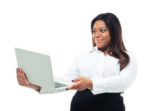 African businesswoman looking at laptop screen Royalty Free Stock Images