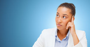 African businesswoman looking up and thinking Royalty Free Stock Images