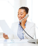 African businesswoman with phone in office Royalty Free Stock Photos