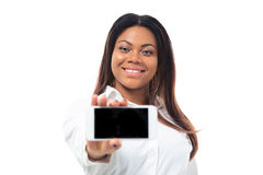 African businesswoman showing smartphone screen Royalty Free Stock Photo