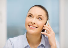 African businesswoman with smartphone in office Royalty Free Stock Image