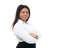 African businesswoman standing with arms folded Stock Image