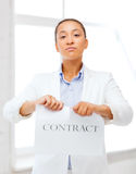 African businesswoman tearing contract Stock Image