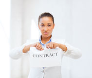 African businesswoman tearing contract Royalty Free Stock Photos