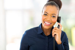 African businesswoman using landline phone Stock Images