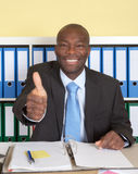 African businssman with blue tie at office showing thumb Stock Images
