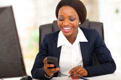 African busniesswoman sms Royalty Free Stock Photo
