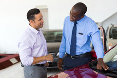 African car salesman customer royalty free stock photo