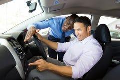 African car salesman customer Royalty Free Stock Photo