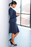 African career woman. Professional african american career woman using cell phone Royalty Free Stock Photography