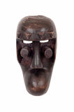African mask. An African ceremonial mask carved in wood isolated on white stock photo