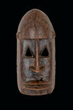 African mask. An African ceremonial mask carved in wood isolated on white royalty free stock photo