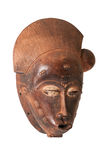 African mask. An African ceremonial mask in the form of a female figure carved in wood isolated on white royalty free stock photo