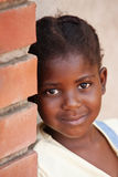 African child. Happy African  girl against a brick wall Royalty Free Stock Image