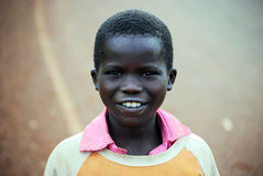 African Child. A boy from Eastern Uganda looks at the camera as he walks home in Kapchorwa, Uganda East Africa Royalty Free Stock Photography