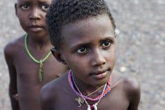 African child. LAKE TURKANA, KENYA- JAN 12: African unidentified El molo child, 7 years old on Jan 12, 2013 in tribal village near lake Turkana, Kenya.The El Royalty Free Stock Images
