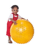 African child. With dreadlocks playing with a ball Stock Photo