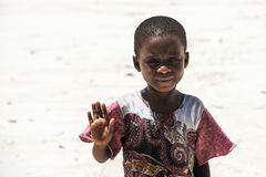 African child at the beach in Zanzibar Island. Even facing severe life conditions, children in rural Africa are joyful and optimistic Stock Photos