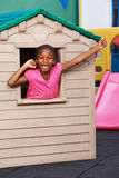 African child cheering in playhouse stock photography