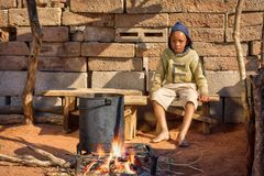 African child cooking in the summer kitchen. African child cooking outdoors, watching supper, kitchen in the village, Botswana Stock Photography