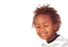 African child with the eyes closed. Isolated on white background royalty free stock photography