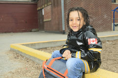 African child in the playground of a shool. An african child in the playground of a shool with raincoat Stock Image