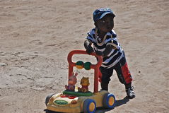 African Child. An African child playing alone Stock Photography
