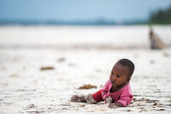 African child playing. Even facing poor life conditions, children in rural Africa are joyful, optimistic and eager to have fun. Image taken on the beach of Royalty Free Stock Photos